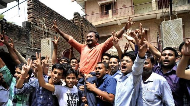 Founder of Super 30, Anand Kumar celebrates along with his students who cracked the IIT entrance test in Patna.(File photo)
