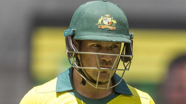 Aaron Finch walks off after being dismissed during the first one-day international (ODI) cricket match against South Africa.(AFP)