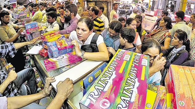 People buy the fire crackers at Essabhai Fire Works for Diwali festival at Masjid Bunder(HT Photo)