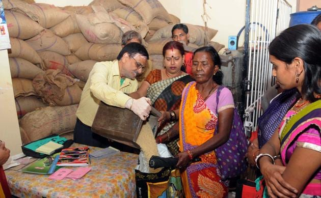 A PDS ration shop in Ranchi. Several leading economists have suggested that India should adopt a Universal Basic Income as its main anti-poverty strategy, replacing existing welfare schemes with direct income transfers into bank accounts of beneficiaries(Diwakar Prasad/ Hindustan Times)