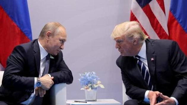 Russia's President Vladimir Putin talks to US President Donald Trump during their bilateral meeting at the G20 summit in Hamburg, Germany, July 7, 2017.(REUTERS)