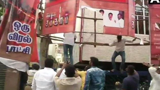 AIADMK workers vandalise posters of Sarkar movie outside Kasi theatre in Chennai.(ANI Photo/Twitter)