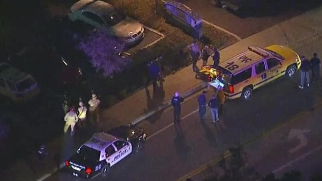 In this image made from aerial video, police vehicles line a road in the vicinity of a shooting in Thousand Oaks, California.(AP)