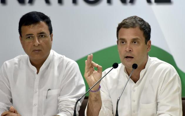 Congress Party president Rahul Gandhi with spokesperson Randeep Singh Surjewala during a press conference on the issue of Rafale deal at the AICC headquarters in New Delhi, September 22. Rahul Gandhi is trying to use this scandal as a lethal weapon during the 2019 election campaign(Sonu Mehta/HT PHOTO)