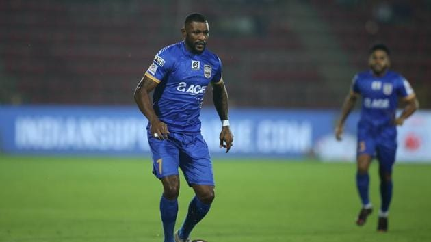 Arnold Issoko of Mumbai City FC in action during match 32 of the Hero Indian Super League 2018 ( ISL ) between NorthEast United FC and Mumbai City FC held at the Indira Gandhi Athletic Stadium.
