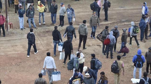 People on poll duty in Jagdalpur on Sunday.(HT Photo)