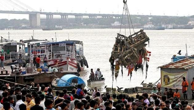 Corporation workers collecting the remnants of the goddess Durga idols after immersion to avoid pollution of river Ganga in Kolkata after the end of Durga puja celebrations(PTI)