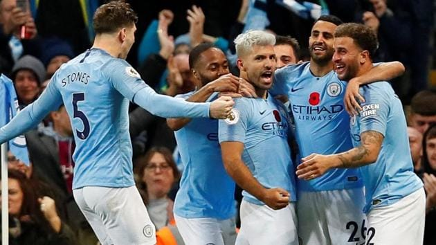Manchester City's Sergio Aguero celebrates scoring their second goal with team mates.(Action Images via Reuters)