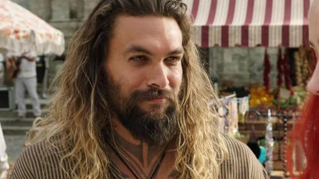 Jason Momoa stars in and as Aquaman. The film releases on December 14.