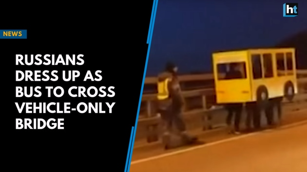Russians dress up as bus to cross vehicle-only bridge