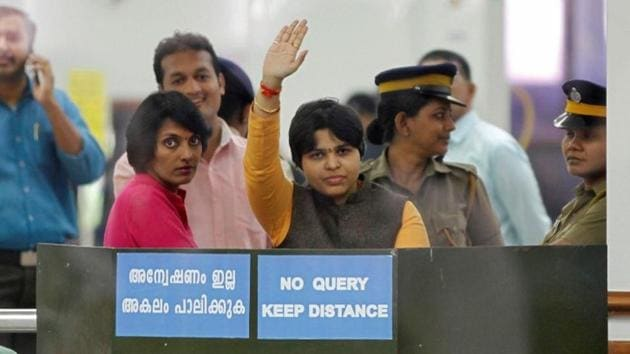 Trupti Desai, a women's rights activist, waves from inside the Cochin International Airport at Kochi on Friday.(REUTERS)