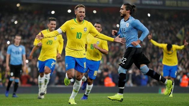 Brazil's Neymar celebrates scoring their first goal from the penalty spot.(Action Images via Reuters)