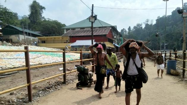 A sudden protest by devotees at the Sabarimala temple surprised the police as the heavy security deployment in the area has affected the pilgrim flow (HT Photo/Vivek Nair)(HT Photo)