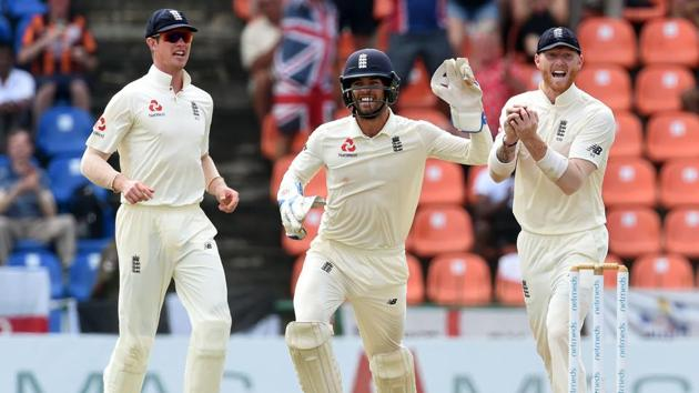 England's wicketkeeper Ben Foakes (C) celebrates with teammates Ben Stokes (R) and Keaton Jennings (L).(AFP)