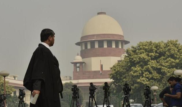 Representational image of a man walks in front of the Supreme Court in New Delhi(Sanjeev Verma/HT PHOTO)