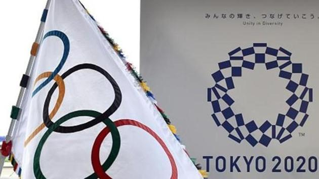 The Olympic flag (left) and the logo of the Tokyo 2020 Games.(AFP/Getty Images)