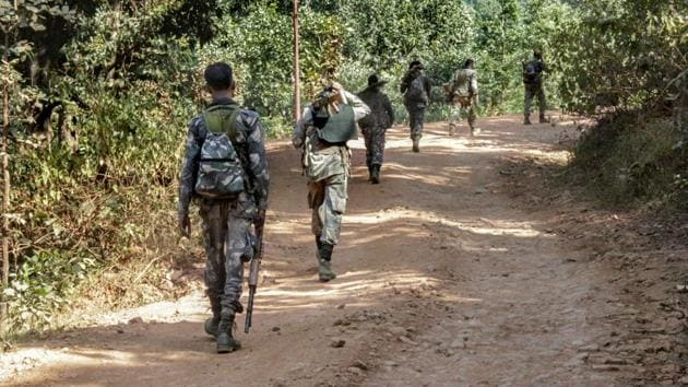Paramilitary jawans patrol along a road during a band called by Maoists in Lohardaga, Jharkhand on Oct 17.(PTI Photo/Representative image)