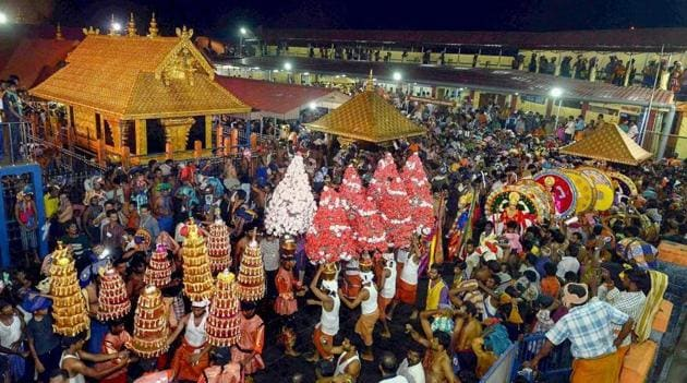 In this file photo dated Dec 24, 2014, a 'Karppoorazhi' procession is being taken out at Lord Ayyappa temple, in Sabarimala.(PTI)
