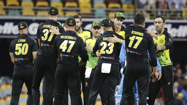 Australia players celebrate after winning the first T20 International cricket match between Australia and India in Brisbane, Australia, Wednesday, Nov. 21, 2018. (AP Photo/Tertius Pickard)(AP)
