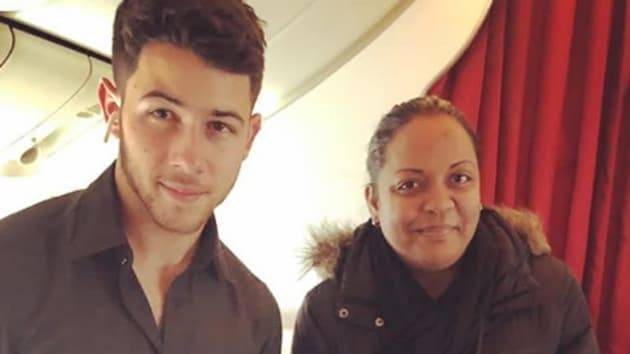 Nick Jonas poses with a fan, presumably on his way to India.