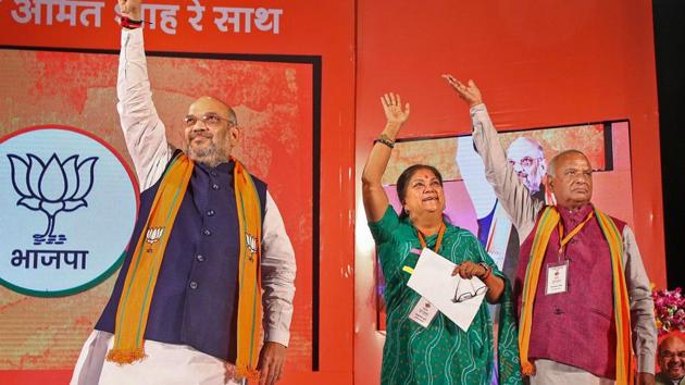 BJP President Amit Shah, Rajasthan Chief Minister Vasundhara Raje and State President Madan Lal Saini during a party event in Jaipur, Wednesday, Nov. 21, 2018.(PTI)