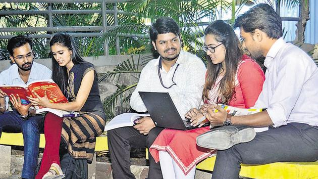 Students of Pumba, are seen preparing for various entrance exams on campus, on Tuesday.(RAVINDRA JOSHI/HT PHOTO)