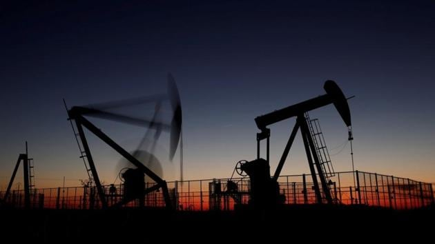 Oil pumps are seen after sunset outside Vaudoy-en-Brie, near Paris. Oil prices fell to their lowest in more than a year on Friday, on course for their biggest one-month decline since late 2014, even as oil producers considered cutting production to try to stem a rising global surplus.(Reuters File Photo)