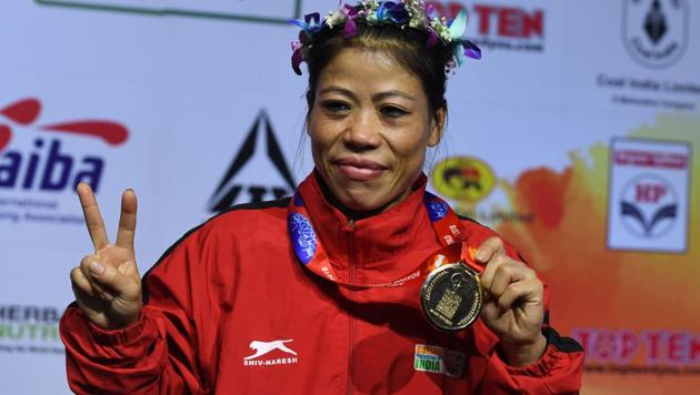 Mary Kom of India gestures with her gold medal after winning the 45-48 kg category final fight at the 2018 AIBA Women's World Boxing Championships in New Delhi on November 24, 2018. (Photo by Sajjad HUSSAIN / AFP)(AFP)