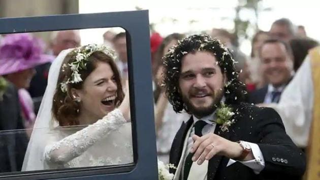 Actors Kit Harington and Rose Leslie react as they leave after their wedding ceremony at Rayne Church, Scotland on Saturday.(AP)(AP)