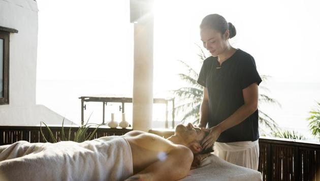 A nice back rub or a foot massage can help in providing relaxation after a long day.(Unsplash)