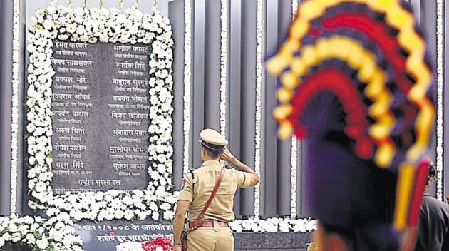 A policeman pays his respects at a 26/11 memorial on the 10th anniversary of the attacks, in Mumbai on Monday.(Reuters Photo)