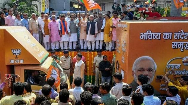 Madhya Pradesh assembly election 2018: Chief minister Shivraj Singh Chouhan and other leaders flag off the election campaign 'Rath' at state party office in Bhopal on October 21.(PTI File Photo)