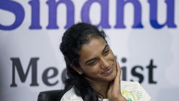 Indian badminton player P.V. Sindhu attends a press conference in Hyderabad, India, Thursday, Aug. 30, 2018. Sindhu won the silver medal for the women's single badminton at the 18th Asian Games in Jakarta, Indonesia(AP)