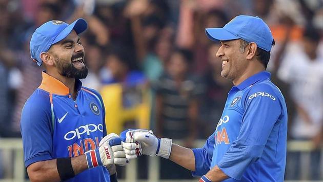Indian batsmen Virat Kohli and MS Dhoni celebrate after the former completed his complete 10,000 ODI runs.(PTI)