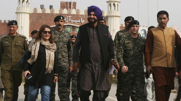 Navjot Singh Sidhu, center, arrives at the Pakistani border post Wagha near Lahore, Pakistan, Tuesday(PTI Photo)