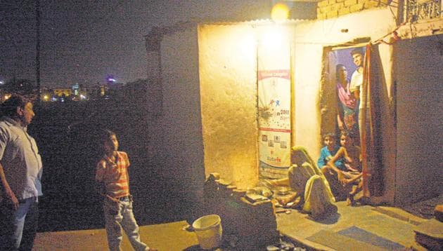 A family in the light of a bulb in a slum. Image for representation.(HT file photo)