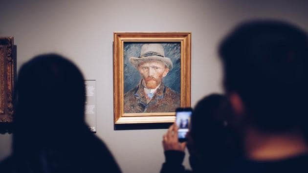 People click a picture of Vincent Van Gogh's painting(Photo by Ståle Grut on Unsplash)