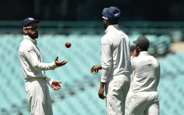 India's captain Virat Kohli (L) throws the ball to Lokesh Rahul (C) whilst fielding on the fourth day of the tour match against Cricket Australia XI at the SCG in Sydney.(AFP)