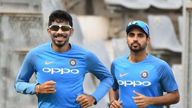 Indian cricketers (L to R) Jasprit Bumrah and Bhuvneshwar Kumar during a training session.(AFP)