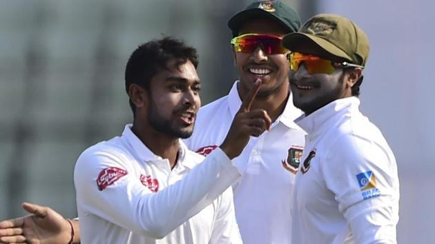 Mehidy Hasan (L) celebrates with teammate Shakib Al Hasan (R) after the dismissal of Shimron Hetmyer.(AFP)