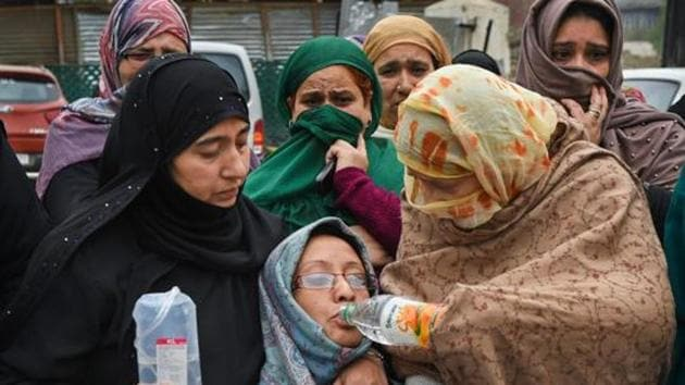 Family members and relatives of a student who went missing from an Uttar Pradesh university staging a silent protest in Srinagar. The student has returned home ( PTI File Photo)(PTI)