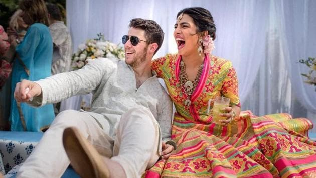 Bollywood actor Priyanka Chopra and American singer Nick Jonas celebrate during their mehendi ceremony, a day before their wedding, at Umaid Bhawan in Jodhpur.(PTI)