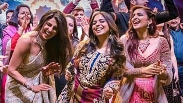 Bollywood actor Priyanka Chopra dances with guests during a ceremony before her wedding with Nick Jonas , at Umaid Bhawan in Jodhpur, India.(AP)
