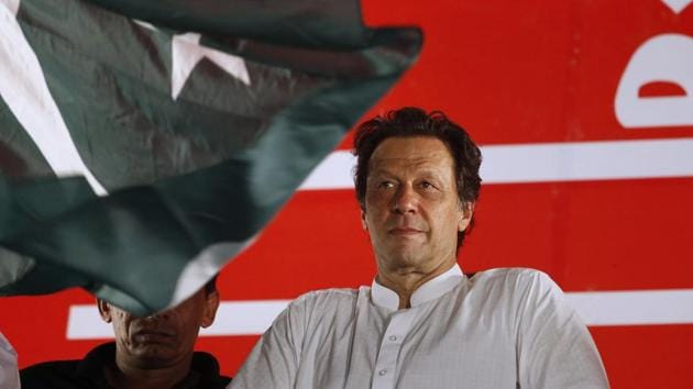 Pakistan prime minister Imran Khan arrives to address an election campaign rally in Islamabad.(AP File Photo)