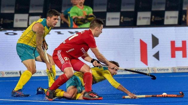 Bhubaneswar: England player (red) Liam Ansell and Australia 's Jake Whetton vie for the ball during a match, in Men's Hockey World Cup 2018, at Kalinga Stadium in Bhubaneswar, Tuesday, Dec 4, 2018.(PTI)