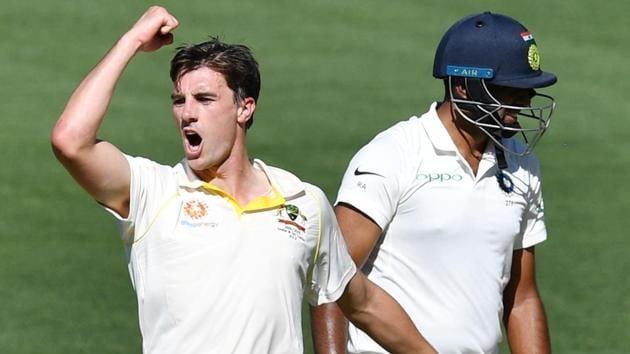 Australia's Pat Cummins reacts after the dismissal of India's Ravichandran Ashwin.(REUTERS)
