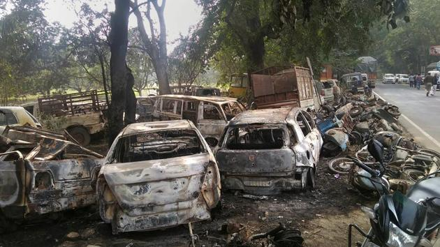 Charred vehicles which were set on fire by a mob in Bulandshahr over alleged cow slaughter.(PTI/File Photo)