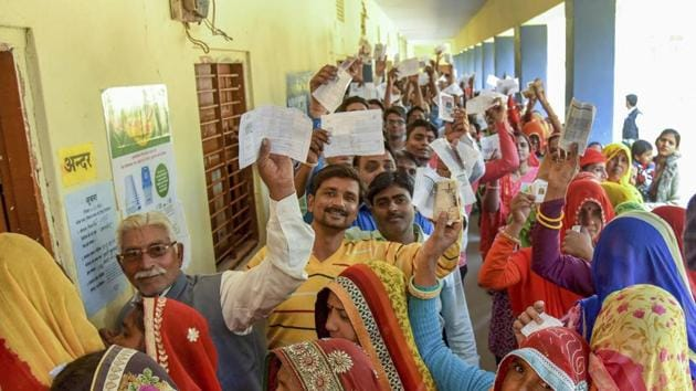Assembly elections 2018: Voters show their identity cards as they wait in queues at a polling station to cast their votes for state Assembly elections, in Jaipur, Friday.(PTI file photo)