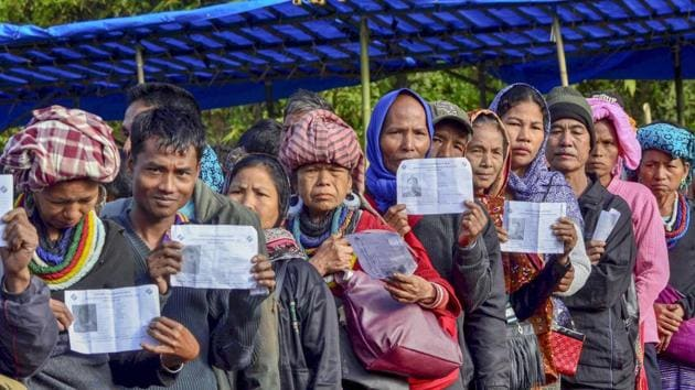 Mizoram elections 2018: Voters show their identity card as they stand in a queue at a polling station during the state Assembly elections, at Kanhmun, Mizoram November 28.(PTI file photo)