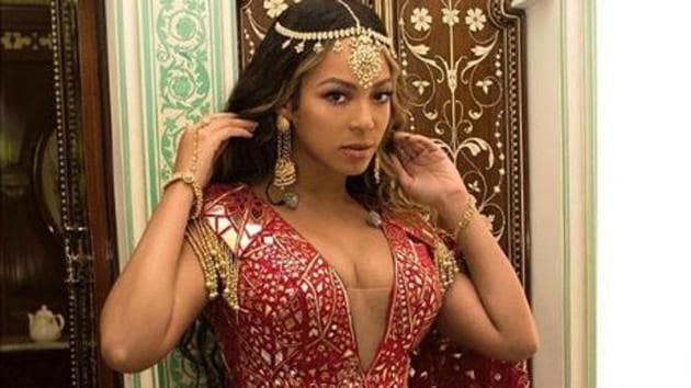 Beyonce chose a number of Indian outfits as she performed at Isha Ambani's sangeet on Sunday.